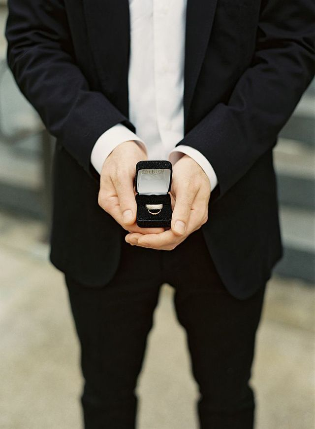 the groom holds the rings | jessica lorren photography | via: ohdeardrea