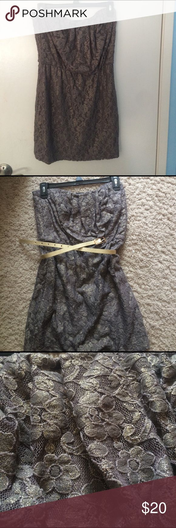 American Rag grey and gold lace dress This size 6 mini dress comes with a gold belt and is very comfortable to wear. Only worn a couple times and is in excellent condition American Rag Dresses Strapless