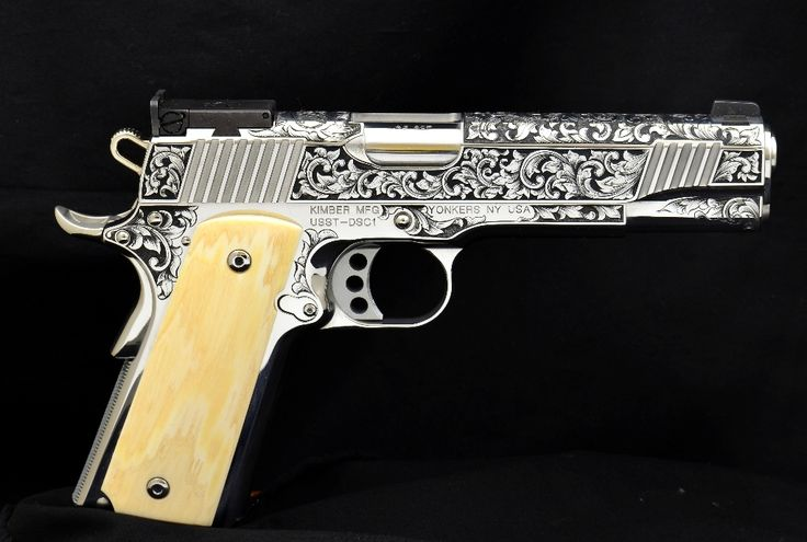This Kimber 1911 was hand engraved by artisan Rob Bunting of Baron's Custom Shop. Early in 2013, it was auctioned off and the proceeds went to benefit the United States Shooting Team. Beautiful.