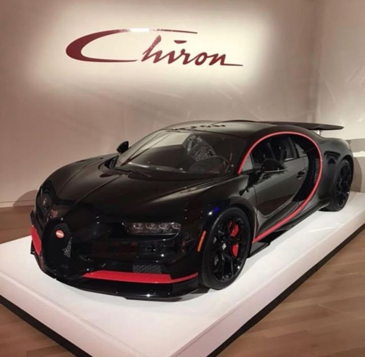 Bugatti Chiron painted in Black w/ Red accents  Photo taken by: @dm.44 on Instagram