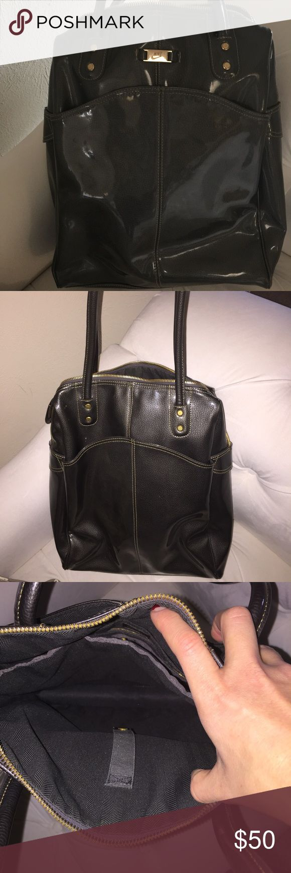 Nike shoulder bag. Great new condition!! Patent leather. Laptop slot. Long shoulder straps for easy carry. Front/easy access pocket on BOTH sides! Great for a carry-on bag or a vinyasa to vino after-work trip! Nike Bags