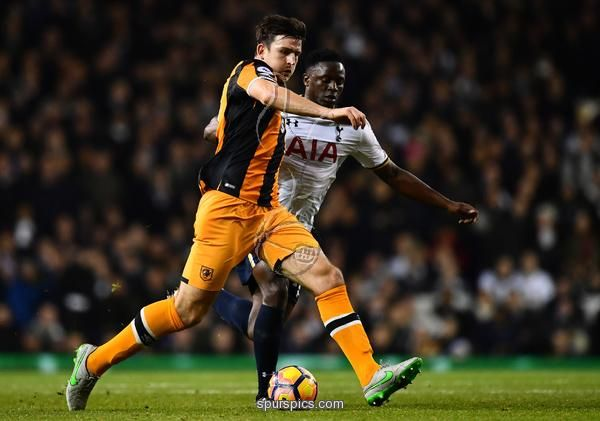 LONDON, ENGLAND - DECEMBER 14: Harry Maguire of Hull City (L) and Victor Wanyama of Tottenham Hotspur (R) battle for possession during the Premier League match between Tottenham Hotspur and Hull City at White Hart Lane on December 14, 2016 in London, England
