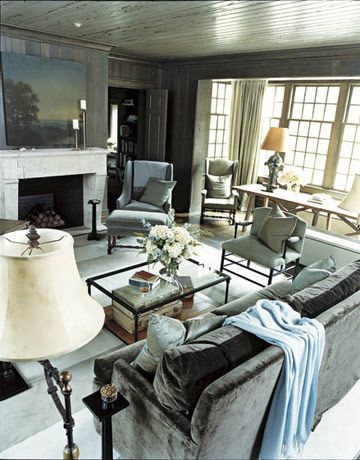 """Natural Living Room                                                         The living room's dark walls bring the outdoors in. """"If you want to see something outside, you light up the yard and cut the lights in the house. It's the same principle here,"""" says McAlpine."""