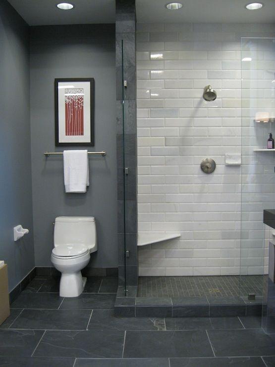 black slate floor white stone subway tile in shower blue gray walls shower surround frameless glass shower