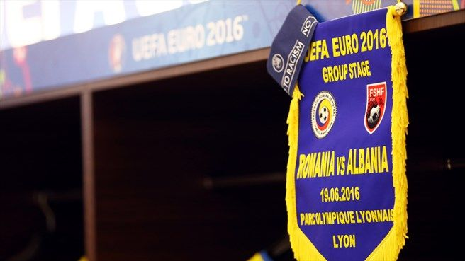 The pennant and a captain's arm band of Albania is pictured prior to the UEFA EURO 2016 Group A match between Romania and Albania