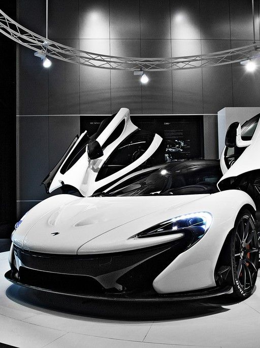 The Ultimate Supercar: McLaren P1 Win a life changing supercar driving experience by clicking on the white beauty