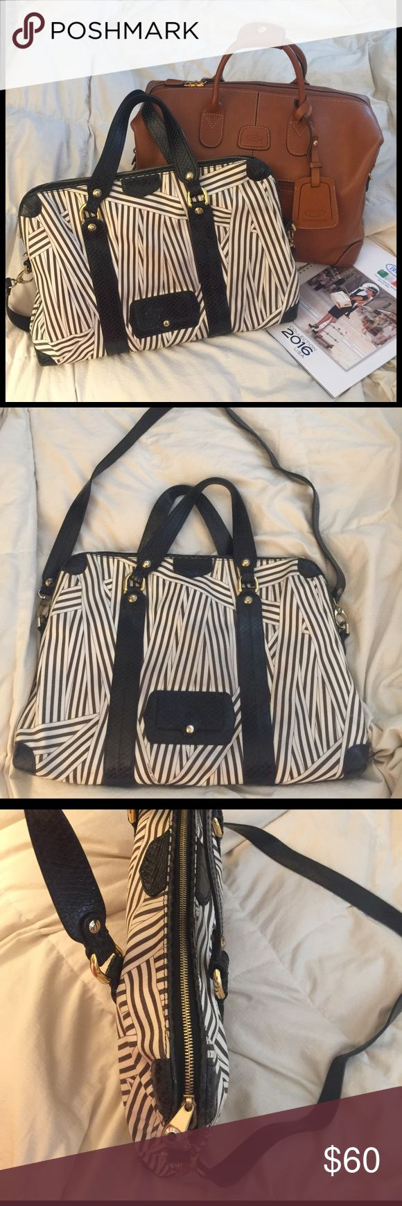 """HENRI BENDEL ladies Laptop messenger bag briefcase HENRI BENDEL ladies' Laptop briefcase / messenger bag, in perfect condition. Used for about a year but the quality on this piece is amazing-- doesn't show any wear. Look chic on your way to the office with this spacious ladies briefcase! Pictured is a 13"""" dell laptop in the laptop compartment. There's about 1 extra inch of length space if your laptop is slightly bigger. Two large slip pockets. Very spacious middle compartment for files…"""