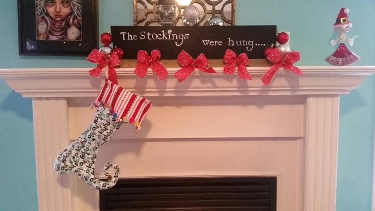 I don't have the money to buy those expensive stocking holders, soooo I created one with stuff just laying around my house!  This is my creation!