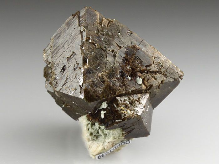 A fine example of Zircon from the Lovozero Massif, Russia. The Zircon crystals is well formed displaying the dipyramid faces, to 3.3cm on edge. DerHammerStein Auction