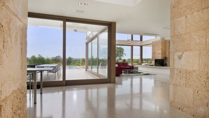 Living room retreat with warm of natural limestone tiled walls. Western Australian Cream Limestone.