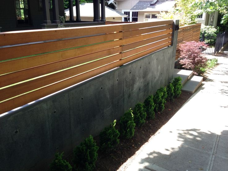 Wood Fence On Top Of Concrete Retaining Wall Backyard