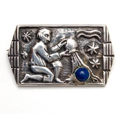 FONS REGGERS 1886-1962 -Silver zodiac-sign brooch Waterman with cabochon cut lapis lazuli design execution by Gebr.Reggers Amsterdam / the Netherlands 1925-'34