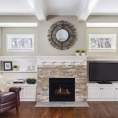 TV next to fireplace could be replicated with pre-manufactured furniture and shelving.