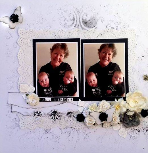 oRight hand side of DOuble Page layout Titled Grandma's Little All Blacks.  Misting on background, heat embossing on die cuts and lots of pretty black and white flowers