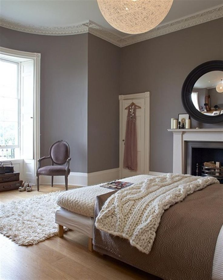 grey bedroom with molding
