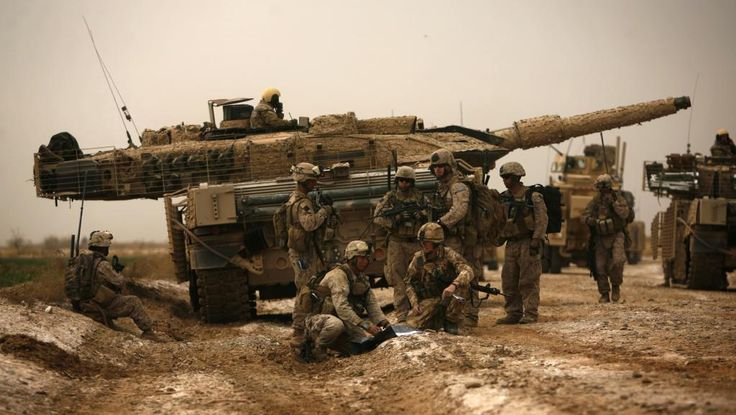 ISAF soldiers clear an improvised explosive device in front of the main battle tank Leopard 2A5DK while traveling to the area of Marge in Afghanistan. 2010 year.
