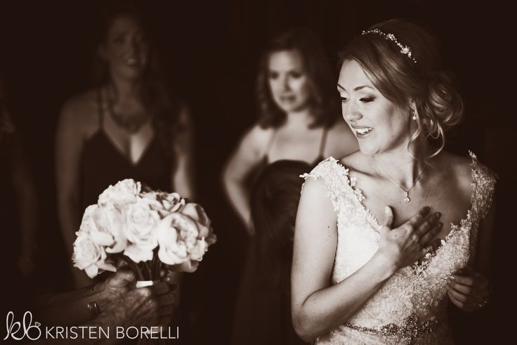 Thetis Island Overbury Resort Wedding. Bride seeing her bridal bouquet.