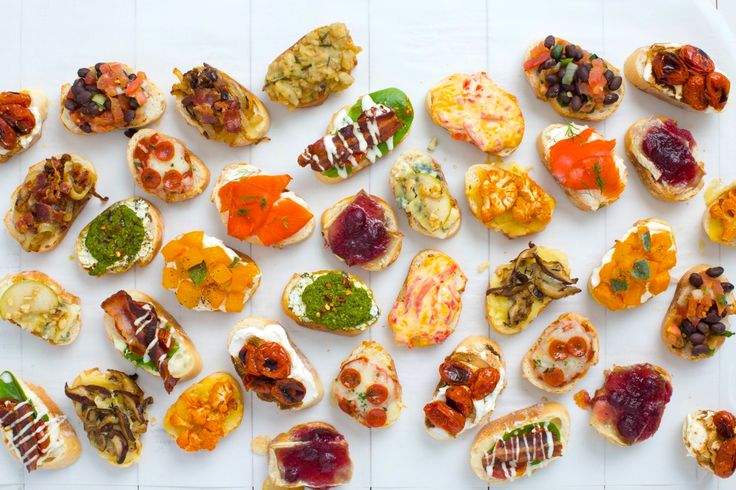 Mini toasts, also known as crostini, are the perfect party appetizer. You can top them with whatever ingredients sound delicious, whether sweet, savory, or spicy. Plus, what's not to love about a little carb-loading at a party?
