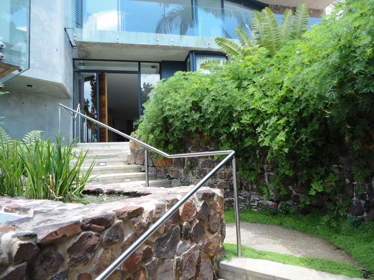 2010 - 2011 House Tucker @ Waterkloof, Pretoria - Old staircase revamped and existing stone walls matched