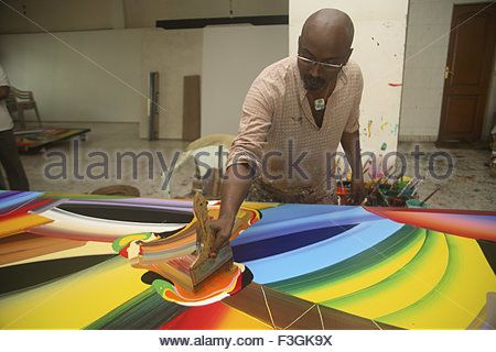 Bose Krishnamachari painting in his studio working on canvas Bombay Mumbai Maharashtra India - Stock Photo
