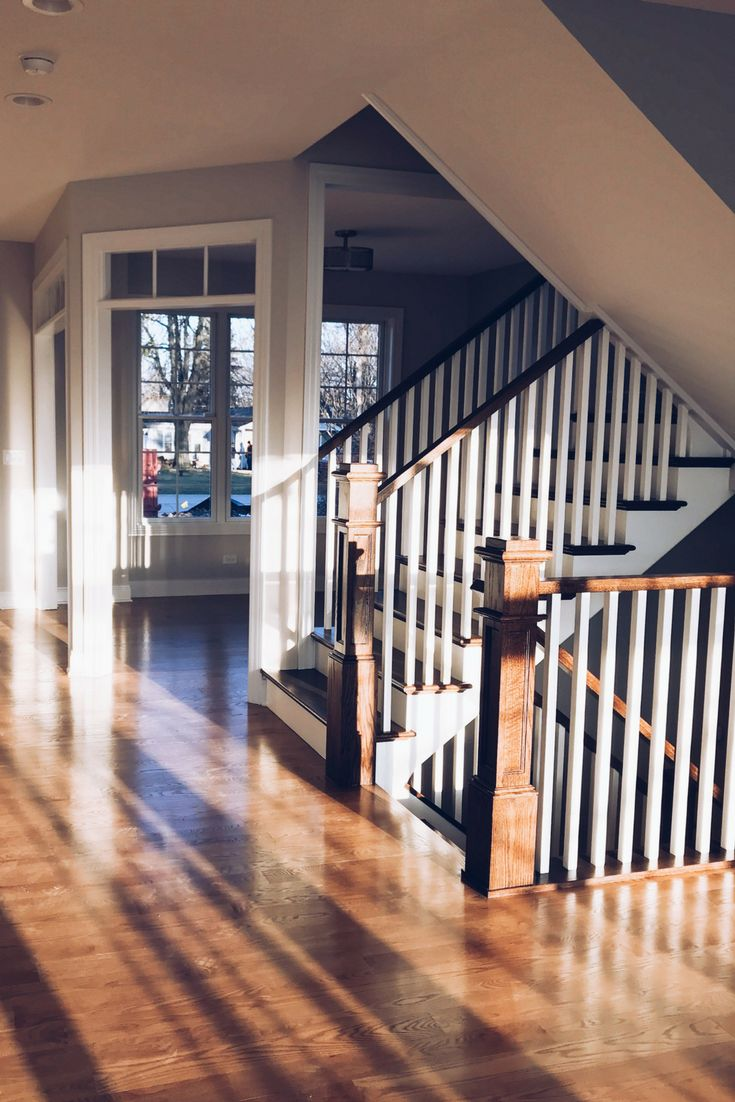 Red Oak Hardwood Floors Stained in Weathered Oak Floor Stain. Stairs stained in Jacobean. Window transoms above doors.