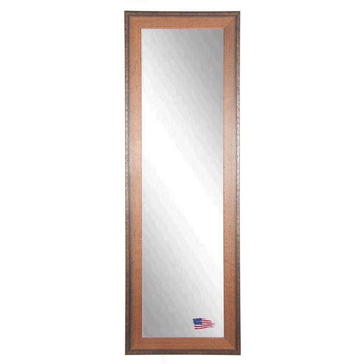 This American craftsman style body mirror demonstrates high quality workmanship with a simple yet classic design.  The finish is a warm walnut tone, with a rivet trim accent. Inner dimensions: 20 inches wide x 58 inches high x 3/16 inches thick Overall dimensions: 26 inches wide x 64 inches high x 1.25 inch deep $417