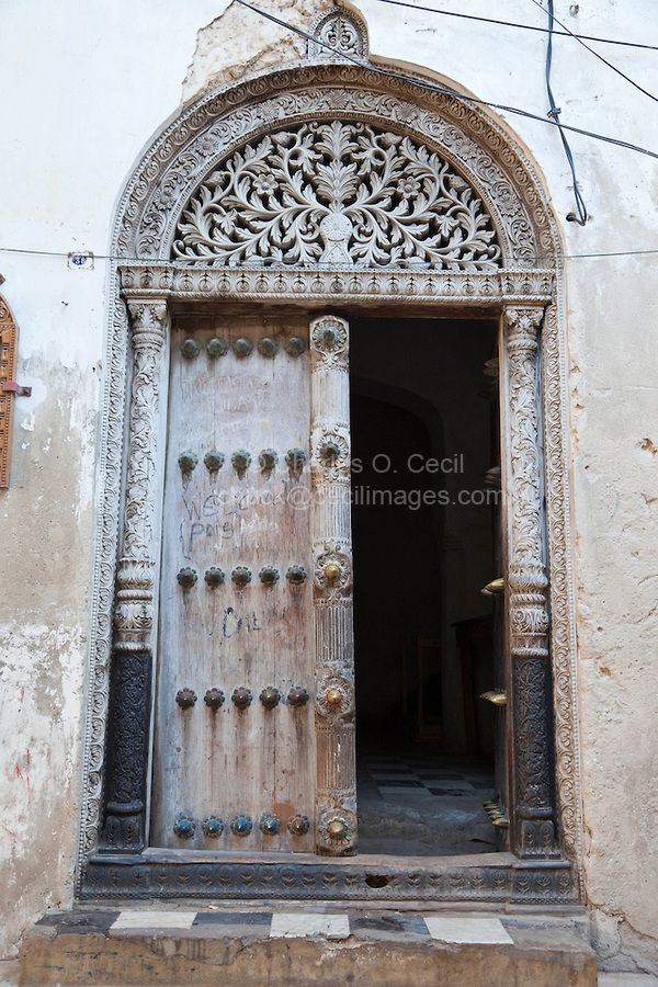 Zanzibar, Tanzania. Door to House of Tippu Tip, Stone Town. The door is carved in the South Asian style, with rounded top. It shows the date 1309 in the Muslim calendar, equivalent to 1891 in the Gregorian. COPYRIGHT:© Charles O. Cecil