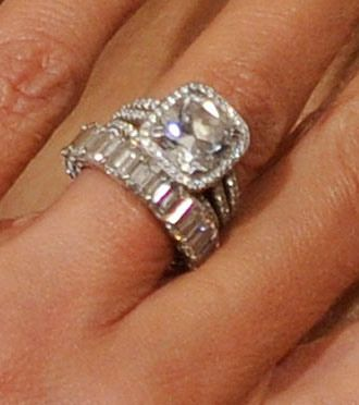 Giuliana Rancic's engagement ring from Bill Rancic. This 4 carat, cushion-cut ring by Graff features a halo of smaller diamonds around the center stone with three thin bands, also encrusted with more diamonds. Wow!