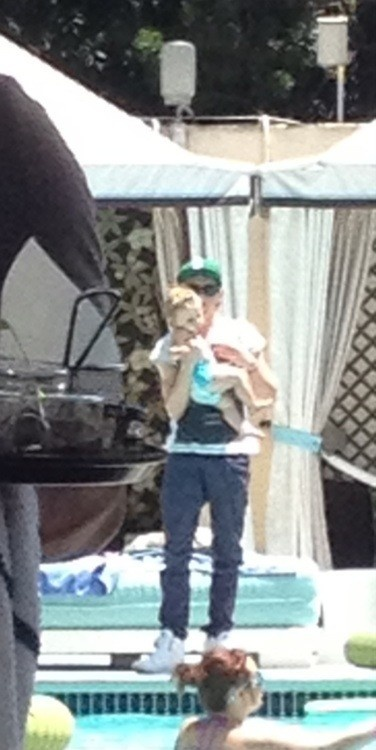 Niall holding Baby Lux...my heart just melted for Niall a little bit more!  Just so adorbs!  Two cuties in right there :)
