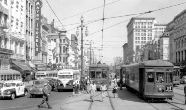 New Orleans Public Service buses and streetcars on a busy Canal Street, late-1940's. I have a stack of bus transfers I found among my dad's ...