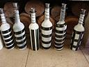"""LACA """"Lo Atamos Con Alambre""""  Candelabros hechos con botellas recicladas"""