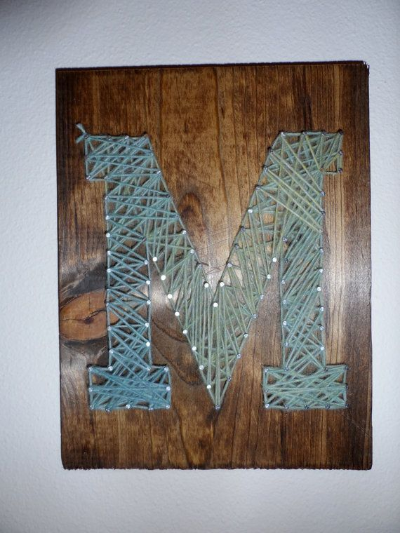 Hey, I found this really awesome Etsy listing at https://www.etsy.com/listing/175813085/letter-nail-art-on-wood-with-yarn