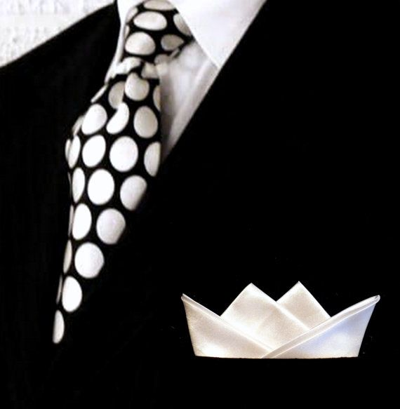 Crisp white custom folded pocket squares #Colgate #OpticWhite #WeddingMonth http://bit.ly/1lc9DHM