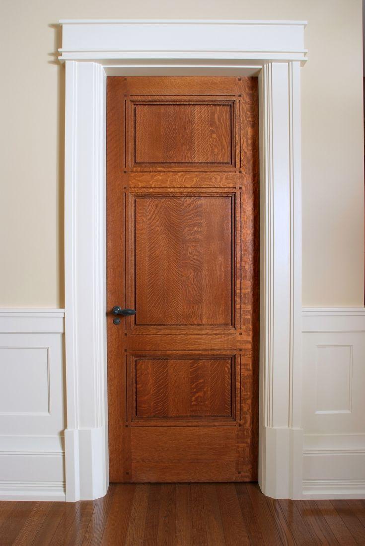 Custom 3 panel quarter sawn white oak interior door with craftsman style painted door casing and