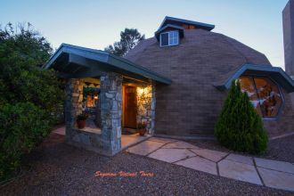 geodesic dome home in Tucson AZ with a cool walkway, windows, and entranceway. [KSPK]
