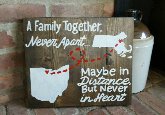 """State to State family A together never apart maybe in distance but never in heart wood sign  12"""" tall x 12"""" wide  completely customizable from state to state and any cities!  All of my signs are handmade and handpainted by me, they may all have different imperfections so please keep in mind they may not all look exactly like the picture.   ANY SIGN CAN BE CUSTOMIZED, PLEASE MESSAGE ME FOR ANY SPECIAL REQUESTS!  *All of my signs DO NOT come with hangers on the back"""