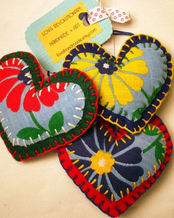 Puffy Fabric Hearts — lovarevolutionary used felt and vintage fabric to make these hand-embroidered heart ornaments.