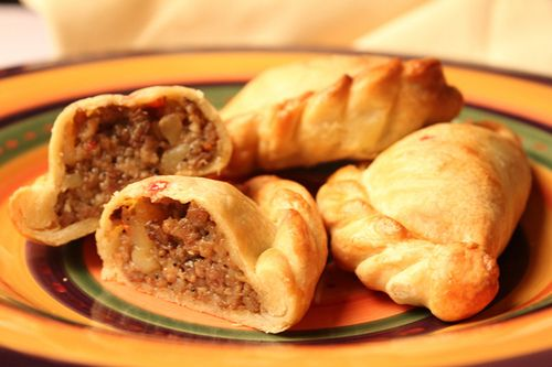 Argentina food called empandas.  Empanadas are made by folding dough or bread with stuffing consisting of a variety of meat, cheese, huitlacoche, vegetables, fruits, and others