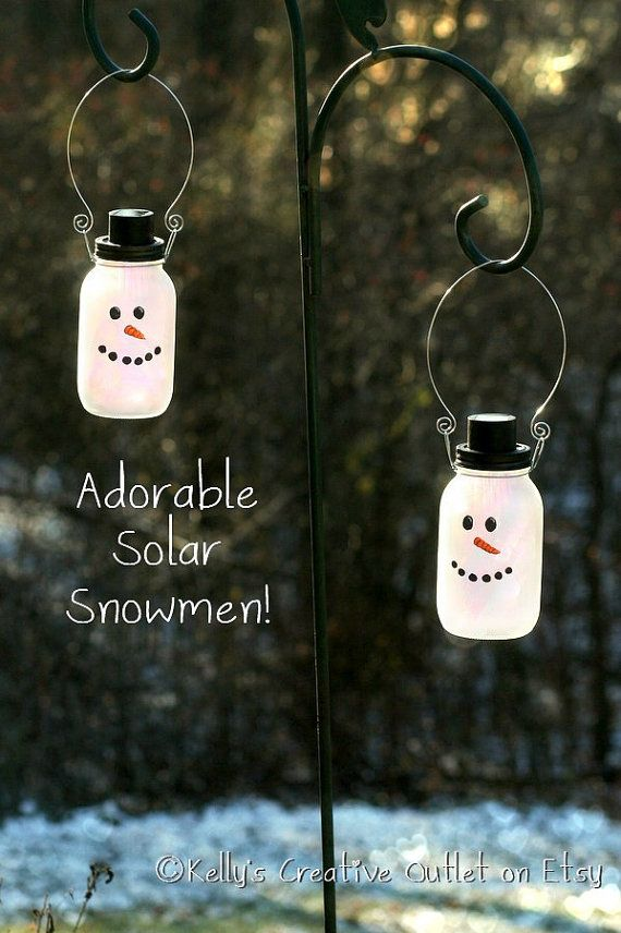 2 Snowman Mason Jars which are also a by KellysCreativeOutlet. How cute would this be hanging outside your window all winter long?? Perfect Christmas present!
