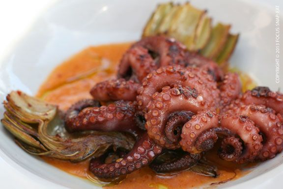 Baby Octopus ($14) with charred tomato vinaigrette, chili and artichoke at Forge Oakland