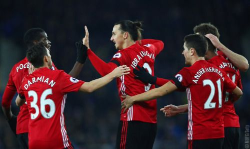 Celebrating/being congratulated by his teammates—they all look like they're a little bit in disbelief that that silly lob /pinball machine goal went in at last. No one was sure until the referee signaled that it did. Add to the list of amazing Zlatan goals. Man United vs. Everton, away.