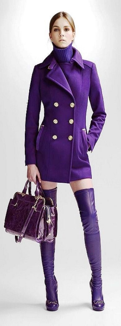 Versace purple thigh high boots, coat, bag, and turtleneck.