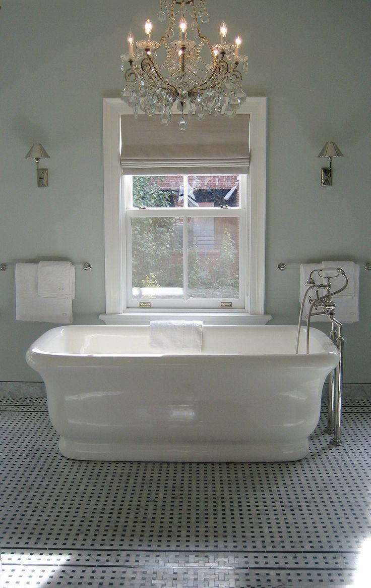 Luxurious freestanding bath - Interior by Nate Berkus. Gorgeous floor and chandelier.