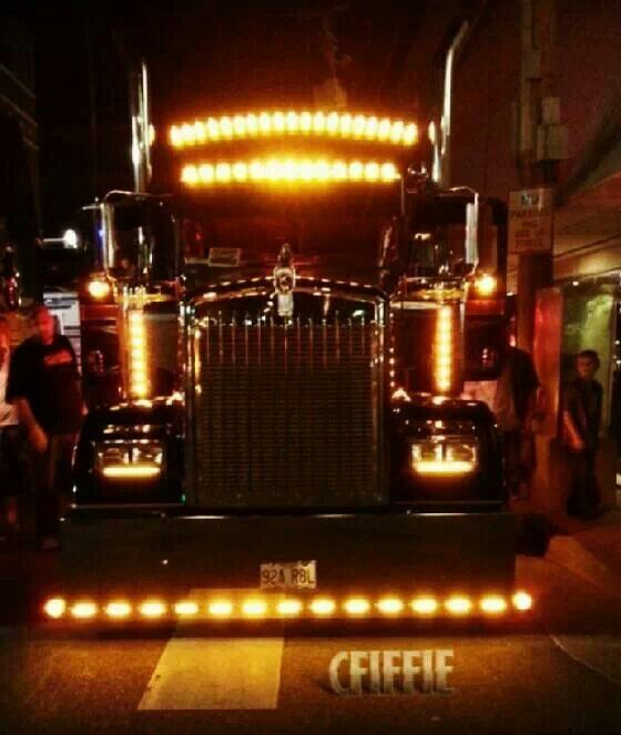 Big rig at night, with Chicken lights.