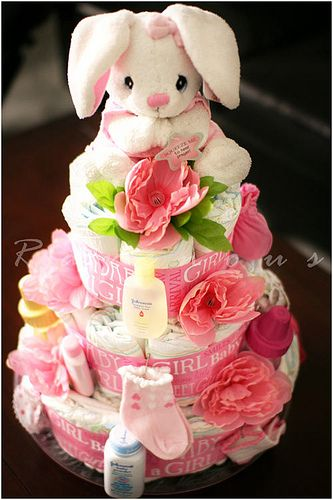 A special baby diaper cake is so practical, creative, and fun to make. These adorable arrangements are made out of diapers that are shaped into a cake and stuffed with little gifts for the baby. These cute gifts are also great centerpieces at baby showers that the Mom-to-be will surely enjoy. While these diaper cakes aren't edible, they're still filled with sweet-sweet thoughts…. DIY