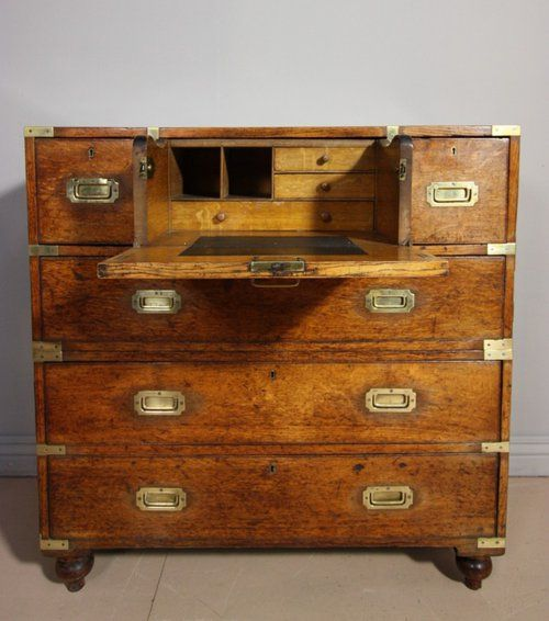 An antique 19th century oak military campaign chest of drawers. Dating from around 1850. This Victorian oak chest features brass bound edges and flush fit handles. There are three drawers over three and it splits in two below the second drawer. Complete with the original internal bureau features in the top centre drawer. In very good condition with the super, original patina/finish. A super piece of antique military campaign furniture.