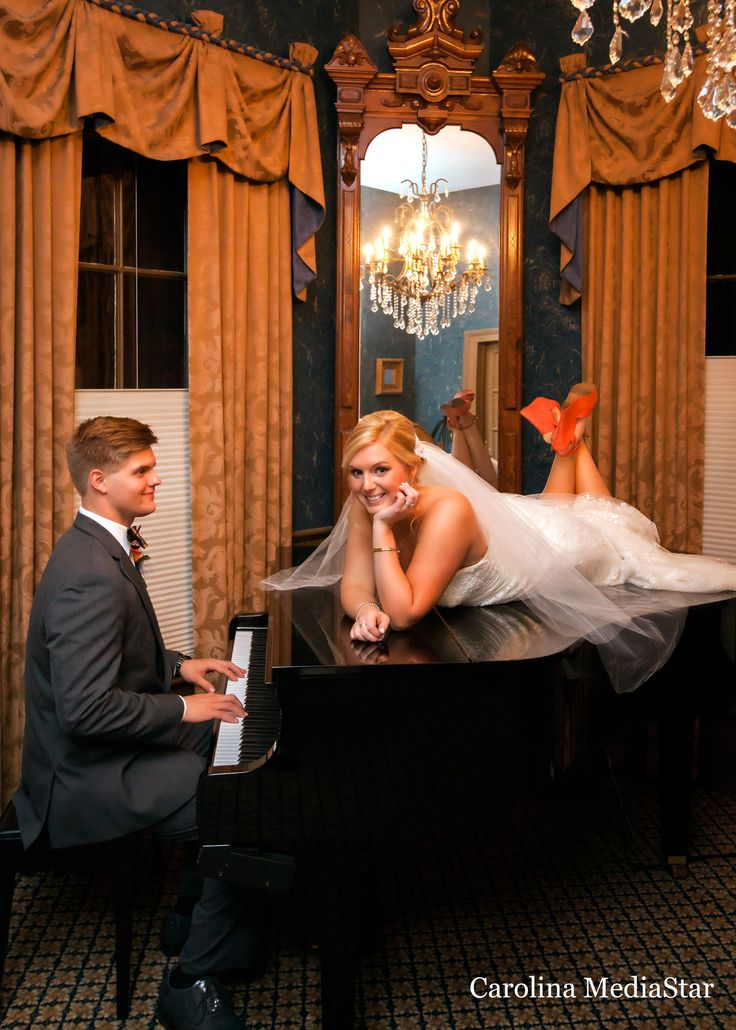 Ethan and Jessica Caldwell, married at the Preston Woodall House.  This dynamic couple was captured in this playful, seductive moment on the Preston Woodall House Yamaha Disklavier baby grand piano.