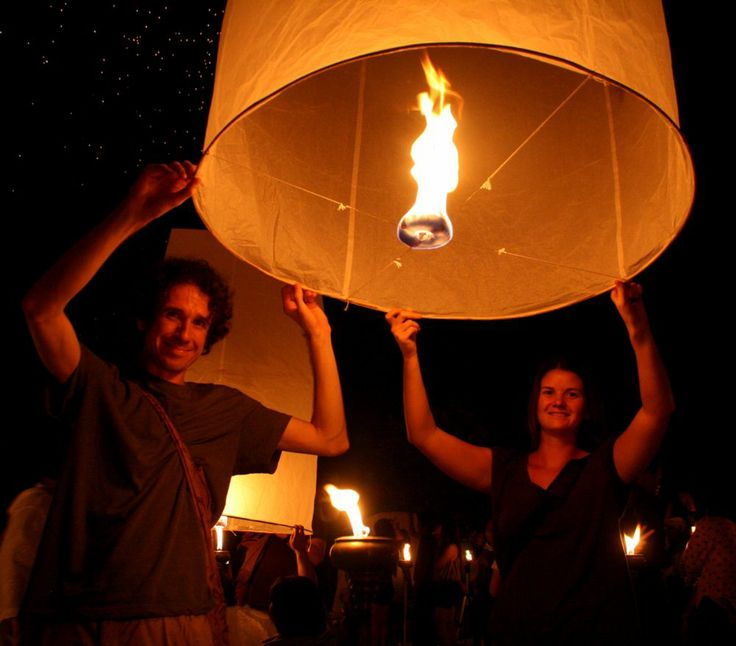 Us taking part in the Yee Peng lantern festival in Chiang Mai. Read on for our Slow Travel Manifesto: http://www.neverendingvoyage.com/slow-travel-manifesto/#