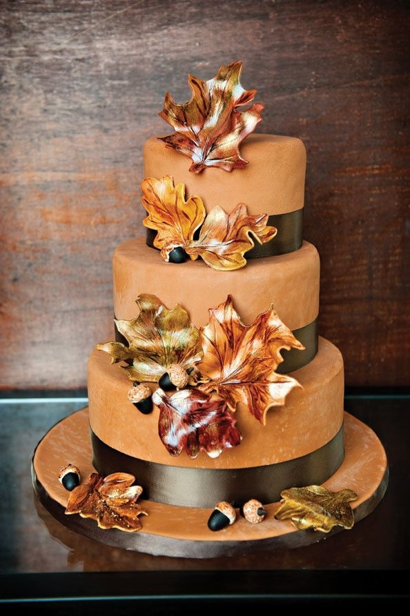 We love the maple leaves made of fondant and beautiful bronze ribbon! {The Cupcake Shoppe}