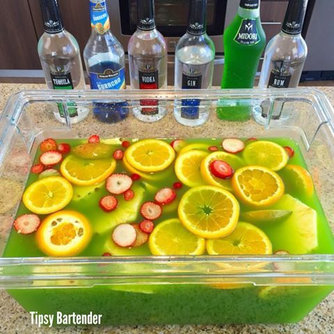 St Patricks Day Jungle Juice - For more delicious recipes and drinks, visit us here: www.tipsybartender.com